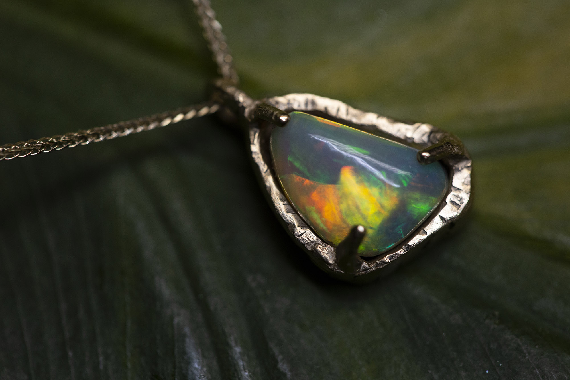 Handmade gold pendant with opal